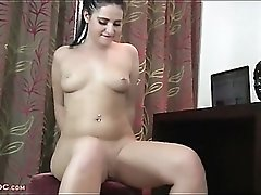 Naked chick in red high heels masturbates