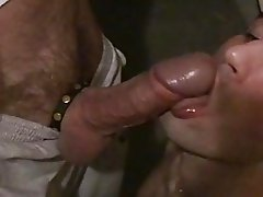 Guy sucking cock and licking balls to a man
