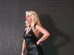 Mistress in Black Latex Catsuit