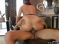 Big ass redhead in stockings gets pounded by black club