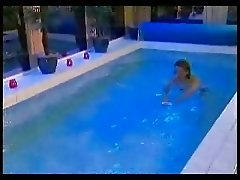 Two horny guy having fun in the swimming pool